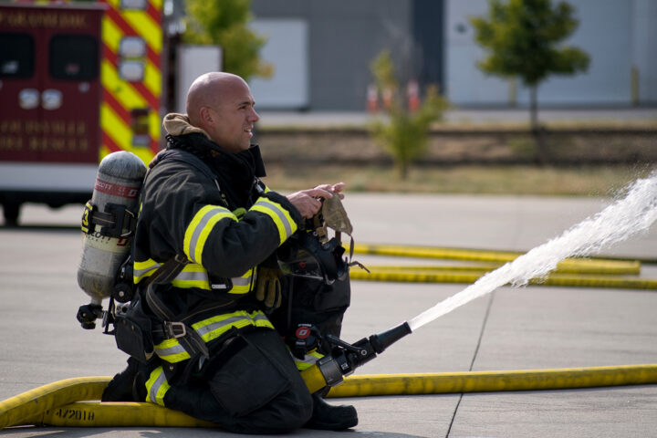 fire fighter with a hose