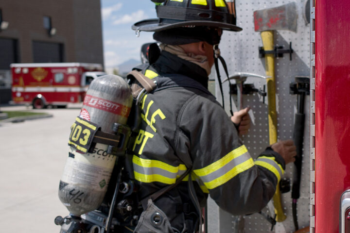 fire fighter grabbing an axe