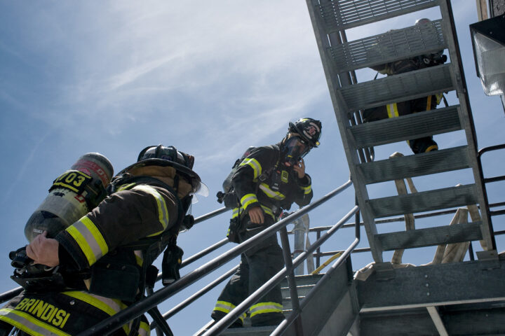 fire gighters going up a fire escape