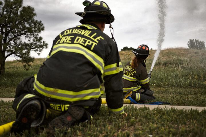 fire fighters hosing a fire