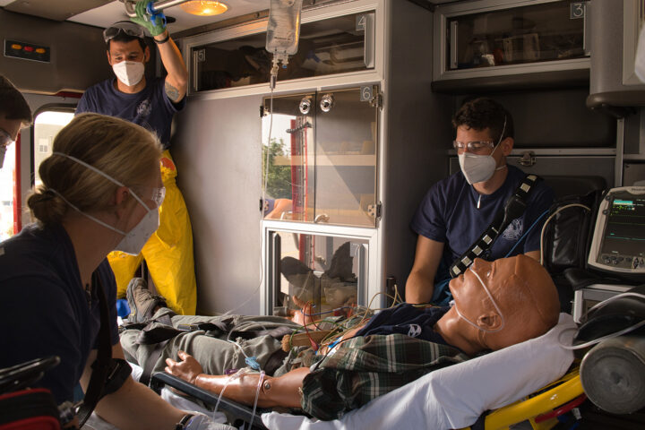 EMTs and dumy in an ambulance